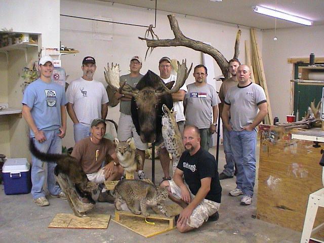 Group shot with mounts: Kneeling L-R Scott Vohnoutka, Bill Neuman. Standing L-R Adam Zwick, Ken Shane, Drew Jacobson, Shawn Bakken, Marty Wiley, Jake Wendolek, Nate Miller.