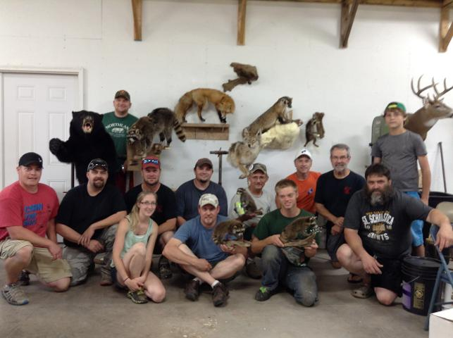Crew & Critters. Participants attending the 2015 Minnesota Taxidermy Guild mount-a-thon held at Fur, Fins, & Feathers Taxidermy in Sauk Rapids, MN.