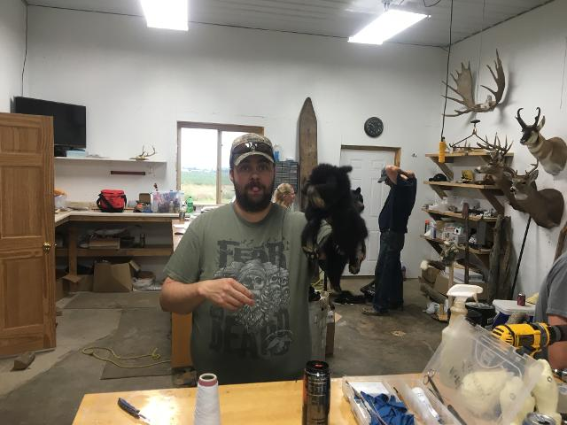 Brad Graber working on a bear cub.